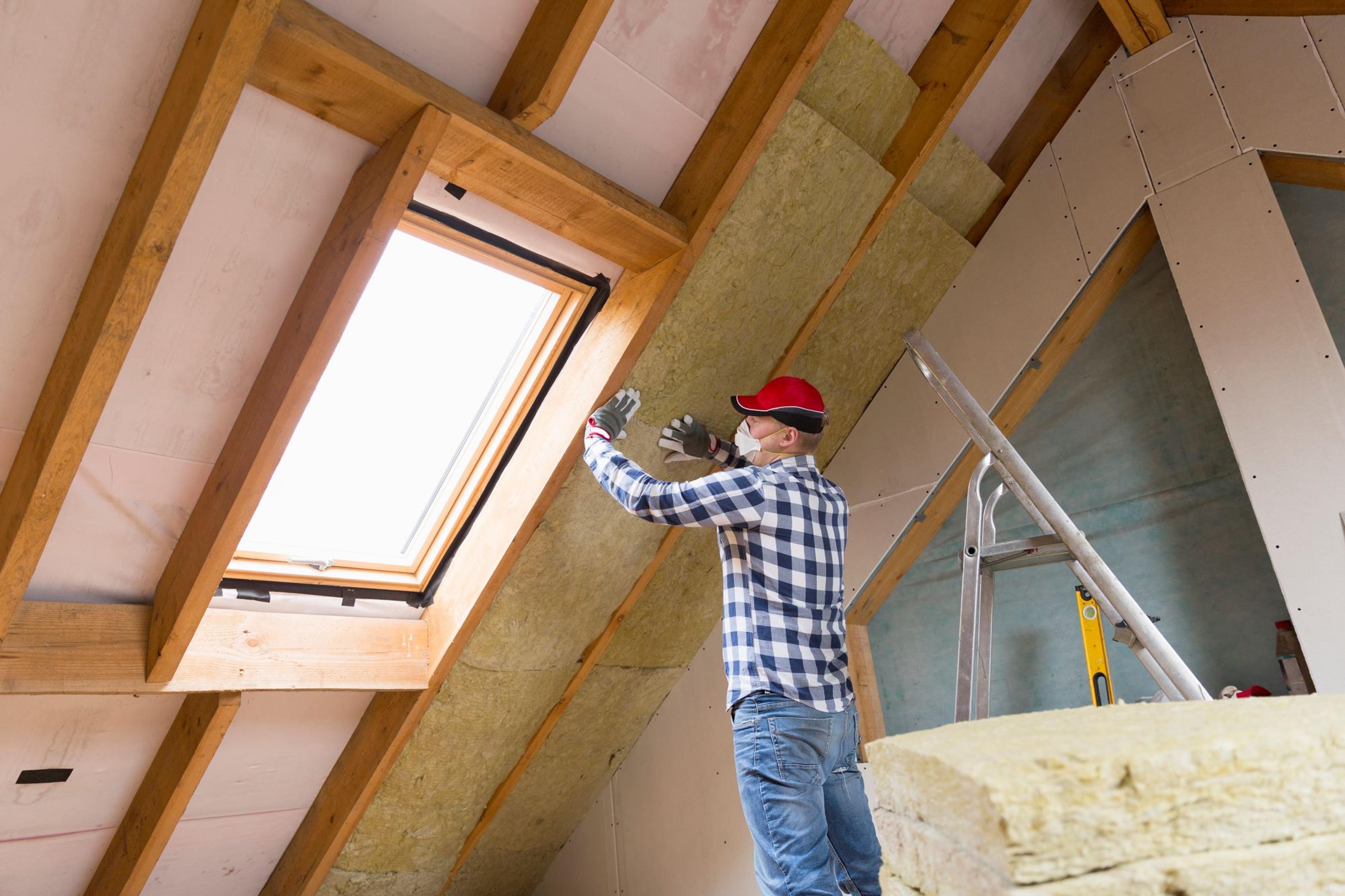 Image of builder insulating loft