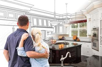 Couple looking at kitchen plans